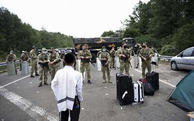 Ukrainian border guards block the road on the Belarus-Ukraine border, in Belarus, September 15, 2020. (TUT.by via AP)