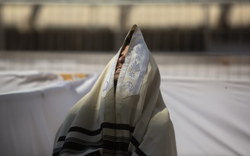 An man prays ahead of the Jewish new year at the Western Wall,  in Jerusalem's old city, September 16, 2020. (AP Photo/Sebastian Scheiner)