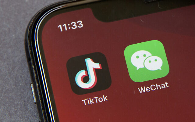 Icons for the smartphone apps TikTok and WeChat are seen on a smartphone screen in Beijing, in a Friday, Aug. 7, 2020 file photo.(AP Photo/Mark Schiefelbein)