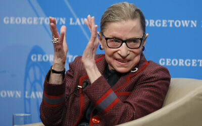 US Supreme Court Justice Ruth Bader Ginsburg applauds after a performance in her honor after she spoke about her life and work during a discussion at Georgetown Law School in Washington, April 6, 2018. (AP Photo/Alex Brandon, File)