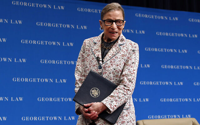 US Supreme Court Justice Ruth Bader Ginsburg leaves the stage after speaking to first-year students at Georgetown Law in Washington, September 26, 2018. (AP Photo/Jacquelyn Martin, File)