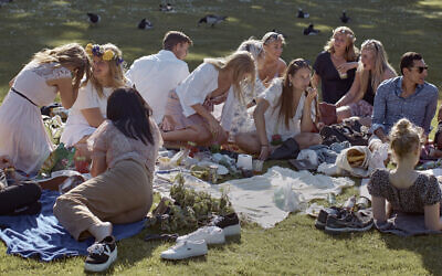 People picnic during the annual Midsummer celebrations in Stockholm, Sweden, June 19, 2020. (AP Photo/Andres Kudacki, File)