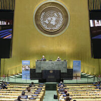 In this photo provided by the United Nations, President of the International Court of Justice, Judge Abdulqawi Ahmed Yusuf, is seen on screens as he addresses the United Nations General Assembly to commemorate the 75th anniversary of the United Nations, September 21, 2020 (Manuel Elías/United Nations via AP)