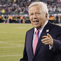In this Oct. 21, 2019, file photo, New England Patriots owner Robert Kraft points to fans as his team warms up before an NFL football game against the New York Jets in East Rutherford, N.J.  (AP Photo/Bill Kostroun, File)