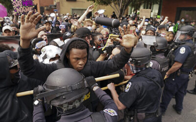 Police and protesters converge during a demonstration on September 23, 2020, in Louisville, Kentucky. (AP Photo/John Minchillo)