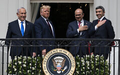 From left to right: Prime Minister Benjamin Netanyahu, US President Donald Trump, Bahrain Foreign Minister Khalid bin Ahmed Al Khalifa and United Arab Emirates Foreign Minister Abdullah bin Zayed al-Nahyan are seen on the Blue Room Balcony after signing the Abraham Accords during a ceremony on the South Lawn of the White House in Washington, September 15, 2020. (AP Photo/Alex Brandon)