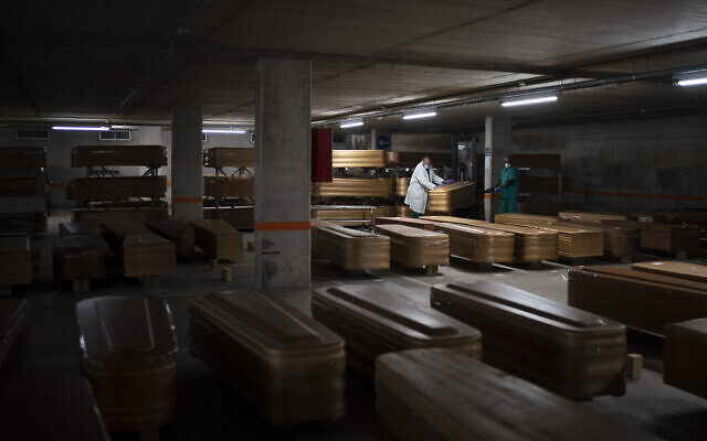 Coffins carrying the bodies of people who died of coronavirus are stored waiting to be buried or incinerated in an underground parking lot at the Collserola funeral home in Barcelona, Spain, April 2, 2020. (AP/Felipe Dana)