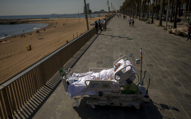 Francisco Espana, 60, looks at the Mediterranean sea from a promenade next to the Hospital del Mar in Barcelona, Spain, Friday, Sept. 4, 2020. Francisco spent 52 days in the Intensive Care unit at the hospital due to coronavirus, but he was allowed by his doctors to spend almost ten minutes at the seaside as part of his recovery therapy. (AP/Emilio Morenatti)