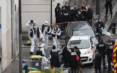 Police officers gather in the area of a knife attack near the former offices of satirical newspaper Charlie Hebdo, September 25, 2020 in Paris. (AP Photo/Thibault Camus)