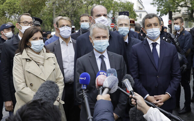 From the left, Paris mayor Anne Hidalgo, anti-terrorism state prosecutor Jean-Francois Ricard , and Interior Minister Gerald Darmanin answer reporters after a knife attack near the former offices of satirical newspaper Charlie Hebdo, September 25, 2020 in Paris. (AP Photo/Lewis Joly)