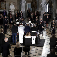 A joint services military team places the flag-draped casket of Justice Ruth Bader Ginsburg as she lies in state at National Statuary Hall in the US Capitol on September 25, 2020. (Greg Nash/Pool via AP)