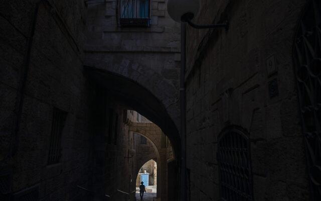 An Ultra-Orthodox Jewish man walks toward the Western Wall, the holiest site where Jews can pray in Jerusalem's Old City ahead of Yom Kippur, September 27, 2020. (AP Photo/Ariel Schalit)