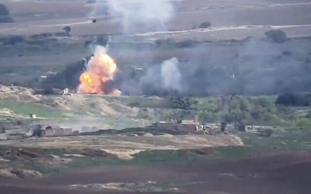 This image taken from a video released by Armenian Defense Ministry on Monday, Sept. 28, 2020 allegedly shows fighting between Armenian and Azerbaijani forces at the contact line of the self-proclaimed Republic of Nagorno-Karabakh, Azerbaijan. (Armenian Defense Ministry via AP)