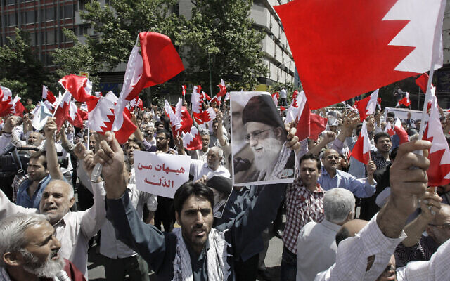 Illustrative: Iranians wave Bahraini flags as they chant slogans during a demonstration in Tehran, Iran, May 18, 2012 (AP Photo/Vahid Salemi)