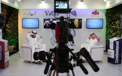Illustrative: An Emirati television anchor and his guest prepare for a program at the Arab Media Forum in Dubai, United Arab Emirates, May 10, 2016. (AP Photo/Kamran Jebreili)