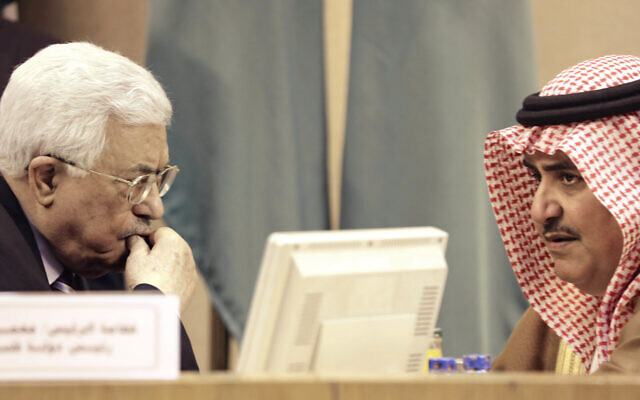 Palestinian Authority President Mahmoud Abbas, left, listens to Bahrain's then Foreign Minister Khalid bin Ahmed al-Khalifa during an emergency Arab League session at in Cairo, Egypt, May 28, 2016. (AP Photo/Amr Nabil)
