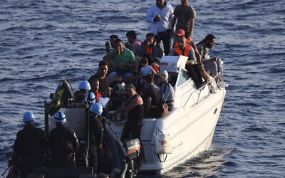 Illustrative: A Brazilian Navy motor boat from the United Nations Interim Force in Lebanon (UNIFIL) approaches a boat overcrowded with migrants in the Mediterranean Sea, October 11, 2018. (UNIFIL via AP)