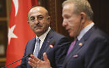 Turkish Foreign Minister Mevlut Cavusoglu, left, listens to his Kosovo counterpart Behxhet Pacolli during a joint press conference in Pristina, Kosovo on October 19, 2018. (AP Photo/Visar Kryeziu)