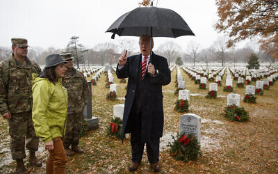 US President Donald Trump speaks as he visits Section 60 at Arlington National Cemetery in Arlington, Va., Saturday, Dec. 15, 2018, during Wreaths Across America Day. (AP Photo/Carolyn Kaster)