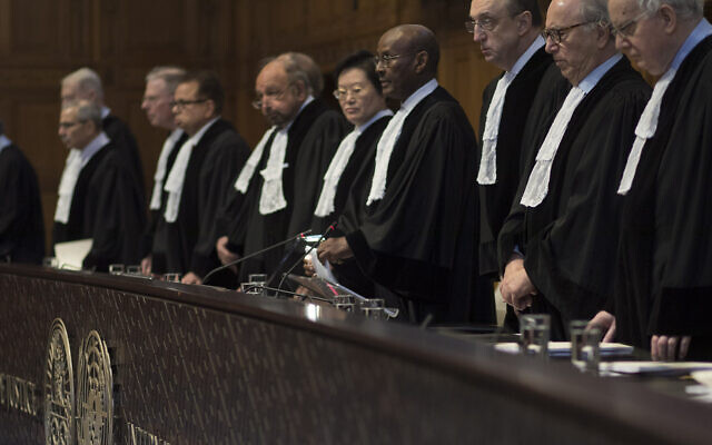 Judges take their seats prior to reading the court's verdict as delegations of Iran and the US listen at the International Court of Justice, or World Court, in The Hague, Netherlands, February 13, 2019.