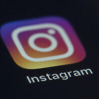 Instagram app icon on the screen of a mobile device in New York on August, 2019. (AP Photo/Jenny Kane)