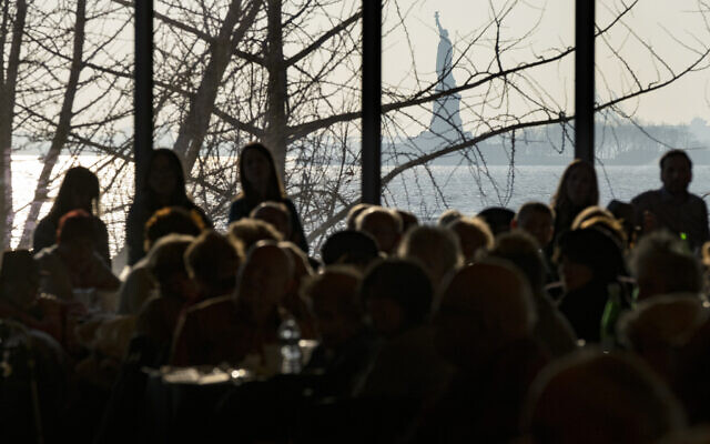 Illustrative: Survivors of the Holocaust and others gather at the Museum of Jewish Heritage as the Statue of Liberty can be seen through a window Sunday, Dec. 22, 2019, in New York, as they recognize International Holocaust Survivors Night, one of several events held around the world. T(AP Photo/Craig Ruttle)