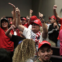 Supporters of US President Donald Trump during a rally for evangelical supporters at the King Jesus International Ministry, Jan. 3, 2020, in Miami. (AP Photo/Lynne Sladky)