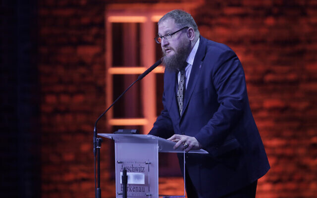 The director of the Auschwitz-Birkenau State Museum Piotr Cywinski delivers a speech during a ceremony at the Auschwitz-Birkenau Nazi death camp in Oswiecim, Poland, January 27, 2020. (AP Photo/Markus Schreiber)