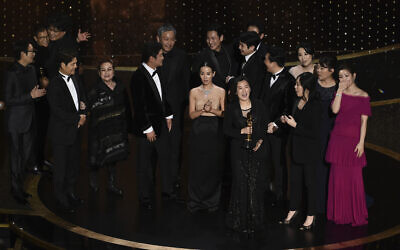 The cast and crew of 'Parasite' accept the award for best picture at the Oscars on Feb. 9, 2020, at the Dolby Theater in Los Angeles. (AP Photo/Chris Pizzello)