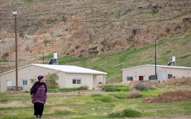 In this Monday, Feb. 10, 2020 photo, a woman walks in the Israeli settlement of Mevo'ot Yericho, in the Jordan Valley near the Palestinian city of Jericho. (AP Photo/Ariel Schalit)