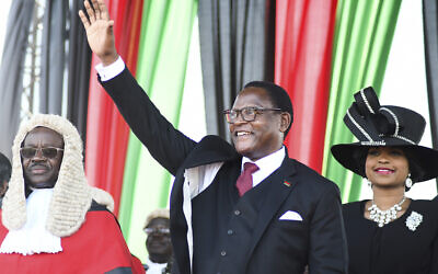 Malawi's newly elected President Lazarus Chakwera greets supporters after being sworn in in Lilongwe, Malawi, June 28, 2020. Chakwera is Malawi's sixth president after winning the historic election held last week, the first time a court-overturned vote in Africa has resulted in the defeat of an incumbent leader. (AP Photo/Thoko Chikondi)