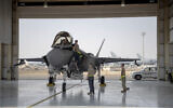 In this August 5, 2019, photo released by the US Air Force, an F-35 fighter jet pilot and crew prepare for a mission at Al-Dhafra Air Base in the United Arab Emirates. (Staff Sgt. Chris Thornbury/US Air Force via AP)