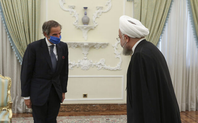 Iranian President Hassan Rouhani, right, welcomes Director General of International Atomic Energy Agency Rafael Mariano Grossi, for their meeting in Tehran, Iran, August 26, 2020. (Iranian Presidency Office via AP)