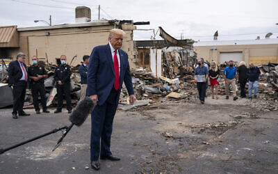 President Donald Trump tours an area Tuesday, Sept. 1, 2020, that damaged during demonstrations after a police officer shot Jacob Blake in Kenosha, Wis. (AP/Evan Vucci)