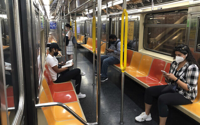 People in face masks ride the subway in Manhattan during the coronavirus pandemic, Aug. 27, 2020 in New York. (AP Photo/Ted Shaffrey)
