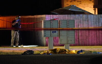 Officials work at a scene late Sept. 3, 2020, where a man suspected of fatally shooting a supporter of a right-wing group in Portland, Oregon the week before was killed as investigators moved in to arrest him in Lacey, Washington (AP Photo/Ted Warren)