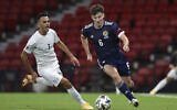 Scotland's Kieran Tierney, right and Israel's Eran Zahavi vie for the ball, during the UEFA Nations League Group F soccer match between Scotland and Israel, at Hampden Park, in Glasgow, Scotland, Friday, Sept. 4, 2020. (Andrew Milligan/PA via AP)
