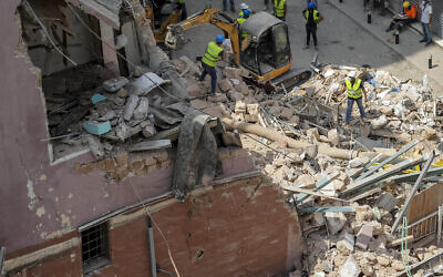 Rescuers search at the site of a collapsed building after getting signals there may be a survivor under the rubble, in Beirut, Lebanon, Sept. 5, 2020 (AP Photo/Hassan Ammar)