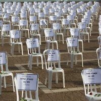One thousand chairs symbolizing people who died from the coronavirus are placed at the Rabin Square in Tel Aviv, Sept. 7, 2020 (AP Photo/Sebastian Scheiner)