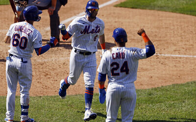 New York Mets' Jeff McNeil celebrates after hitting a home run during the seventh inning of a baseball game against the Philadelphia Phillies on Sept. 7, 2020, in New York. (AP Photo/Adam Hunger)