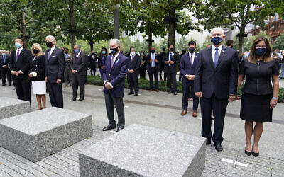 From left, New York Governor Andrew Cuomo, Jill Biden with her husband Democratic presidential candidate Joe Biden, former NYC Mayor Mike Bloomberg, Vice President Mike Pence and his wife Karen, observe a moment of silence during a ceremony organized by the Tunnel to Towers Foundation on September 11, 2020, in New York. (AP Photo/Mary Altaffer)