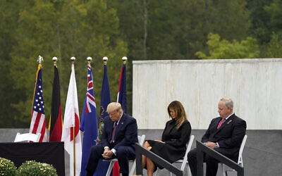 US President Donald Trump, first lady Melania Trump and Interior Secretary David Bernhardt pause during a moment of silence at a 19th anniversary observance of the September 11 terror attacks, at the Flight 93 National Memorial in Shanksville, Pennsylvania, September 11, 2020. (AP Photo/Alex Brandon)