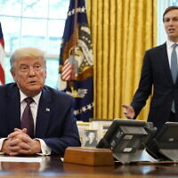 US President Donald Trump listens as Jared Kushner speaks in the Oval Office of the White House on September 11, 2020, in Washington, after Trump announced the US had brokered a peace deal between Israel and Bahrain. (AP/Andrew Harnik)