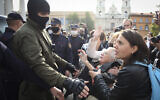 Women gesture, standing in front of a police line during an opposition rally to protest the official presidential election results in Minsk, Belarus, Saturday, Sept. 12, 2020. (Tut.by via AP)