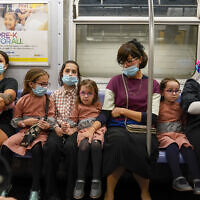 A family rides the train, Monday, Sept. 14, 2020, in the Brooklyn borough of New York. (AP/Mary Altaffer)