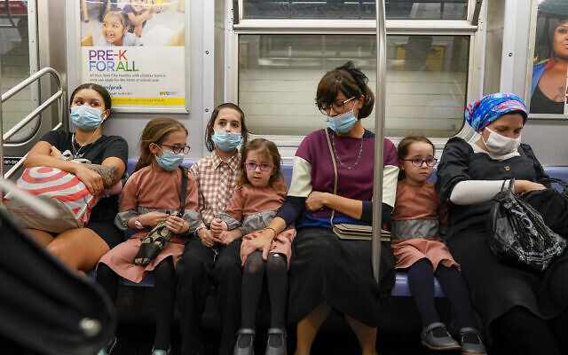 A family rides the train, Monday, September 14, 2020, in the Brooklyn borough of New York. (AP/Mary Altaffer)