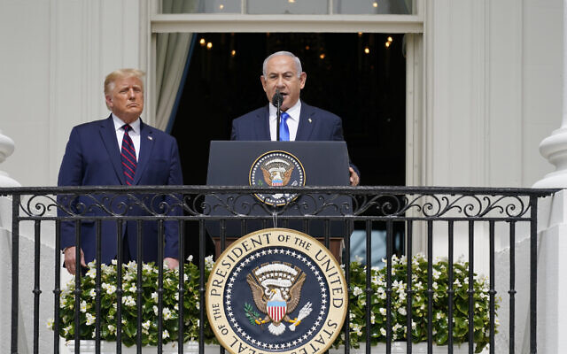 Prime Minister Benjamin Netanyahu (right) with US President Donald Trump, during the Abraham Accords signing ceremony on the South Lawn of the White House, in Washington, September 15, 2020. (Alex Brandon/AP)