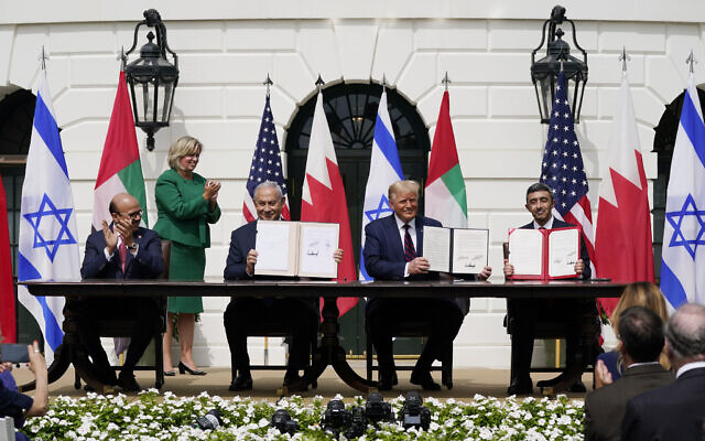 US President Donald Trump, center, with from left, Bahrain Foreign Minister Khalid bin Ahmed Al Khalifa, Israeli Prime Minister Benjamin Netanyahu, Trump, and United Arab Emirates Foreign Minister Abdullah bin Zayed al-Nahyan, during the Abraham Accords signing ceremony on the South Lawn of the White House, Tuesday, Sept. 15, 2020, in Washington. (AP Photo/Alex Brandon)