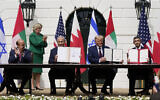 US President Donald Trump, center, with from left, Bahrain Foreign Minister Khalid bin Ahmed Al Khalifa, Israeli Prime Minister Benjamin Netanyahu, Trump, and United Arab Emirates Foreign Minister Abdullah bin Zayed al-Nahyan, during the Abraham Accords signing ceremony on the South Lawn of the White House, September 15, 2020, in Washington. (AP Photo/Alex Brandon)
