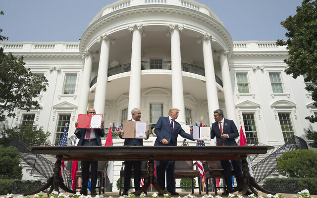 US President Donald Trump, center, with from left, Bahrain Foreign Minister Abdullatif bin Rashid Al-Zayani, Prime Minister Benjamin Netanyahu, and United Arab Emirates Foreign Minister Abdullah bin Zayed al-Nahyan, during the Abraham Accords signing ceremony on the South Lawn of the White House on September 15, 2020, in Washington. (AP Photo/Alex Brandon)
